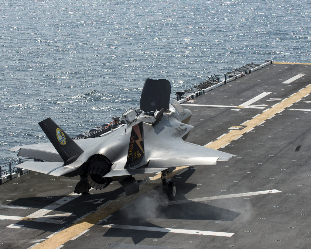 A United Kingdom Royal Air Force test pilot takes off from the USS Wasp on Aug. 13, 2013. The flight marked the first time a U.K. military pilot flew an F-35B short takeoff mission at sea