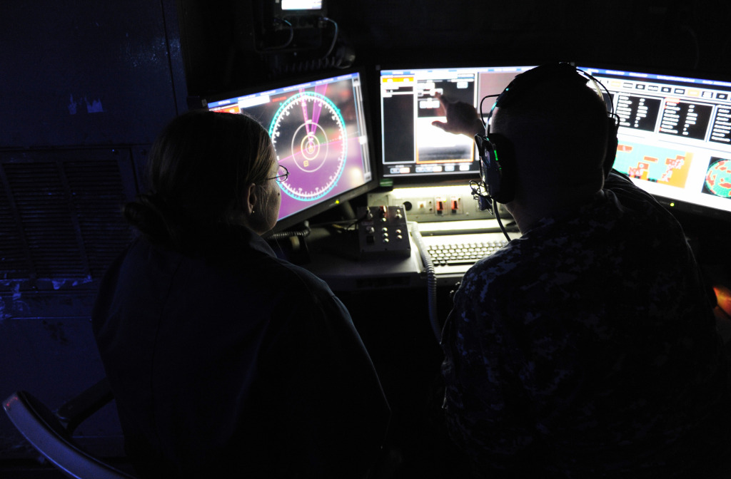Chief Fire Controlman Brett Richmond, right, and Lt. j.g. Katie Woodard, operate the Laser Weapon System