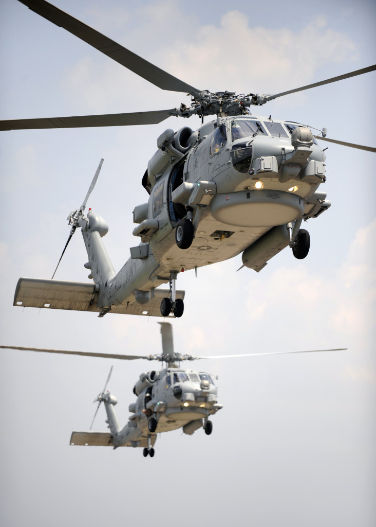 Two multi-mission MH-60R Sea Hawk helicopters fly in tandem