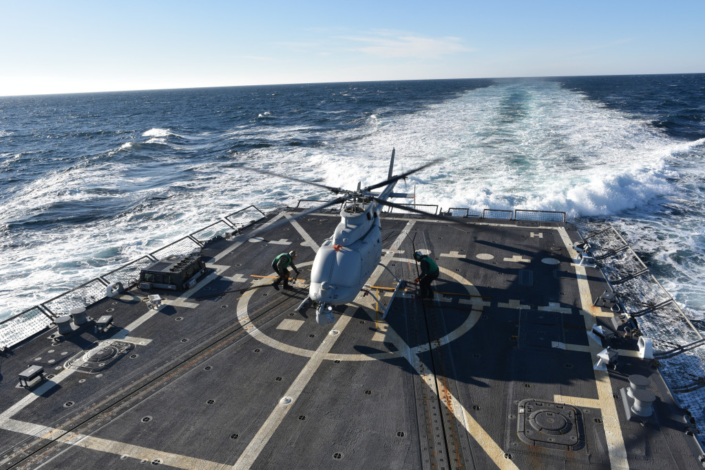 The MQ-8C Fire Scout sits on the deck of the guided-missile destroyer, USS Jason Dunham (DDG 109), after making its first flight Dec. 16, off the Virginia coast. (Photo by Northrop Grumman)