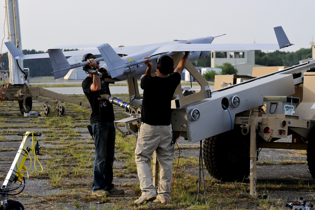 Technicians prepare an RQ-21A Small Tactical Unmanned Aircraft System for it's first flight from the Webster Field Annex at Naval Air Station Patuxent River