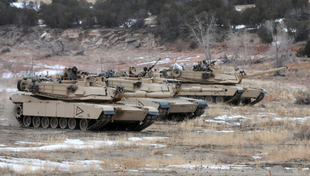 U.S. Army Soldiers with Company D, 2nd Battalion, 8th Infantry Regiment, 2nd Brigade Combat Team, 4th Infantry Division, come on line in an M1A2 Abrams Tank before moving on to assault an objective during breach training near Fort Carson's Camp Red Devil, Colorado