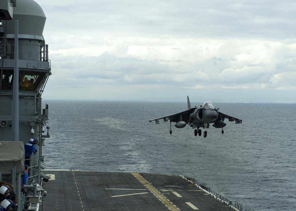 An AV-8B Harrier assigned to Marine Attack Squadron (VMA) 311 lands aboard the amphibious assault ship USS America (LHA-6), marking the ship's first launch and recovery of the aircraft
