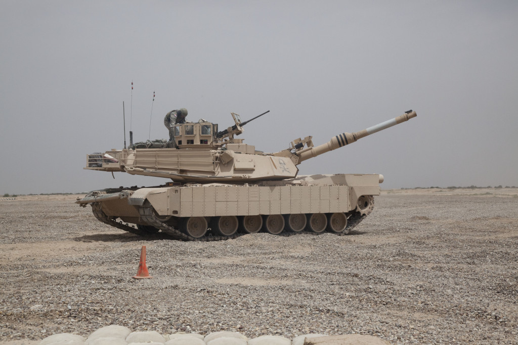 U.S. Army soldiers assigned to 3rd Armored Cavalry Regiment, Thunder Squadron, climb into an Abrams M1A2 SEP at FOB Hammer, Iraq