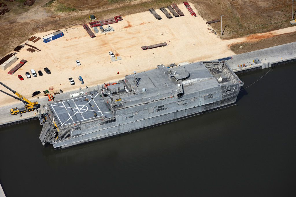The JHSV includes a flight deck for helicopter operations and an off-load ramp that allows vehicles to quickly drive off the ship