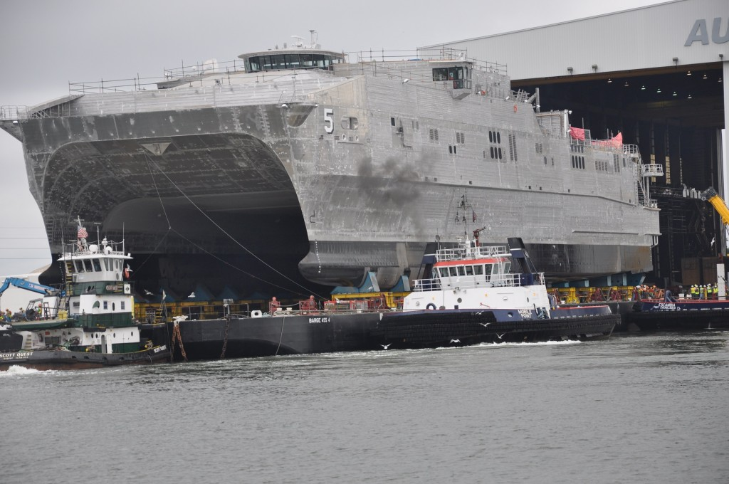 The future Military Sealift Command joint high-speed vessel USNS Trenton (JHSV 5) rolls out in preparation for launch at Austal USA shipyard