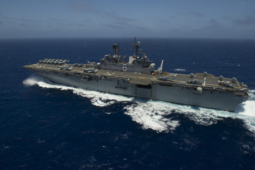 The amphibious assault ship USS America (LHA 6) performs flight operations while underway to Rim of the Pacific 2016