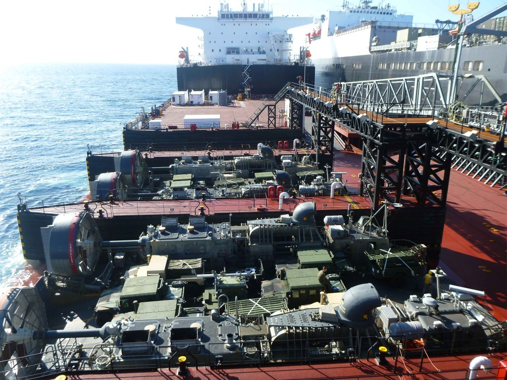 USMC (U.S. Marine Corps) Vehicles transit from vehicle cargo ship USNS Dahl (T-AKR 313) on to Montford Point and are loaded on two LCACs, which will deliver the equipment ashore during the Pacific Horizon 2015 exercise
