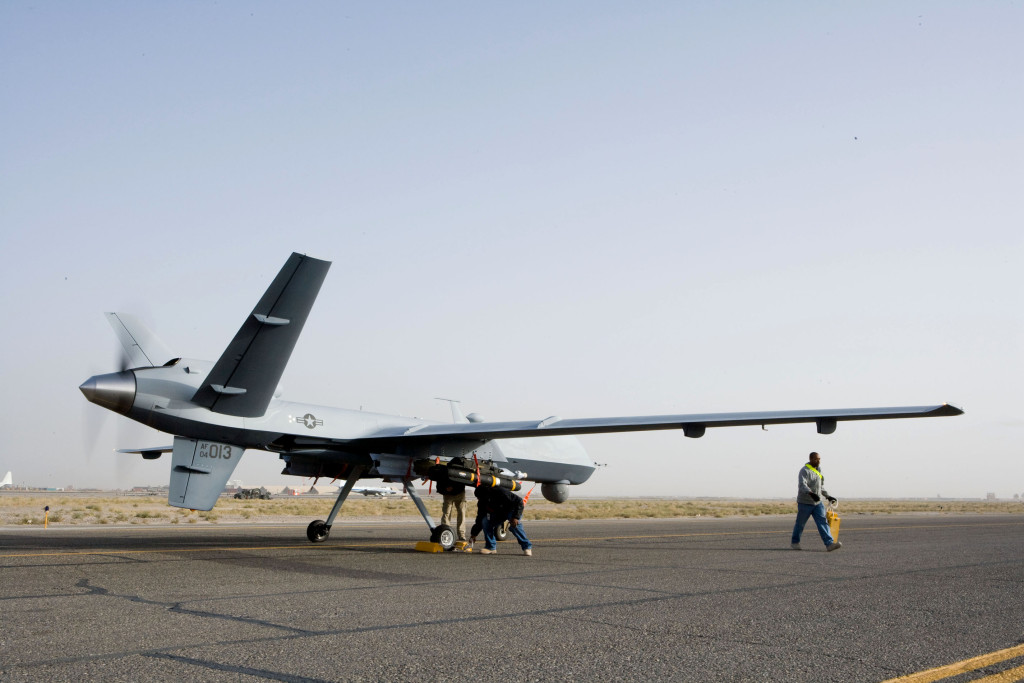 Aircrews perform a preflight check on an MQ-9 Reaper before it takes off on a mission in Afghanistan Oct. 1. The Reaper is larger and more heavily-armed than the MQ-1 Predator and attacks time-sensitive targets with persistence and precision, to destroy or disable those targets. (Courtesy photo)