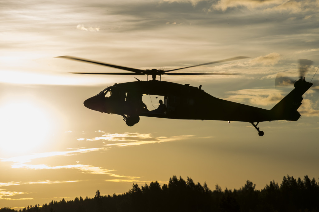 A UH-60 Black Hawk assists in airborne operations on June 22, 2014, near Adazi Training Area. Approximately 600 paratroopers from the 173rd Airborne Brigade have been deployed to Poland, Lithuania, Estonia and Latvia to conduct expanded land force training by demonstrating their commitment to NATO objectives of sustaining interoperability between allied forces (U.S. Army National Guard photo by Sgt. Sara Marchus, 116 Public Affairs Detachment/ Released)