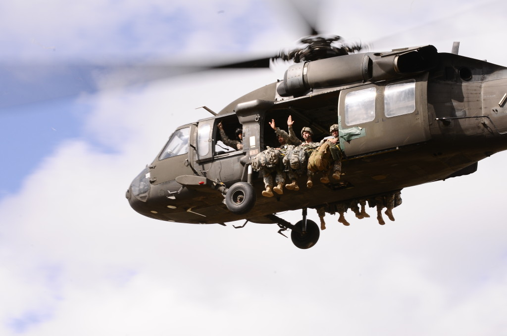 U.S. Soldiers with the 1st Battalion, 143rd Infantry Regiment, Texas Army National Guard, take off in a UH-60 Black Hawk helicopter, waving to family and friends, at Camp Swift, Texas, Sept. 7, 2013. The exercise was part of the unit's family day and the unit's participation in the Paratrooper and Special Olympics event (U.S. Army National Guard photo by Spc. Michael Giles/Released)