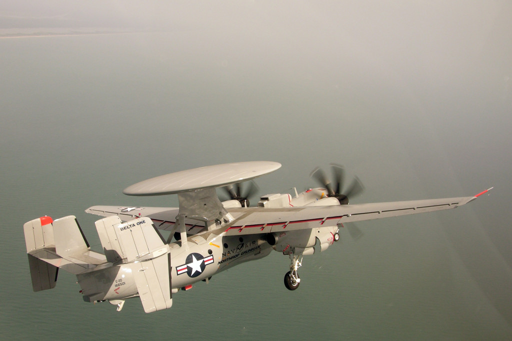 The E-2D is a twin engine, five crewmember, high-wing turboprop aircraft with a 24-foot diameter radar rotodome attached to the upper fuselage