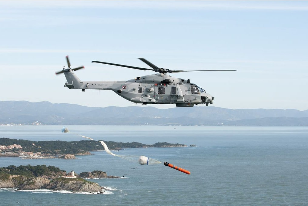 A French navy NH90 Caiman anti-submarine warfare helicopter seen here during operational trials of its primary ASW weapon, the MU90 lightweight torpedo. The helicopter has now obtained its combat qualification in the ASW role (FR navy photo)