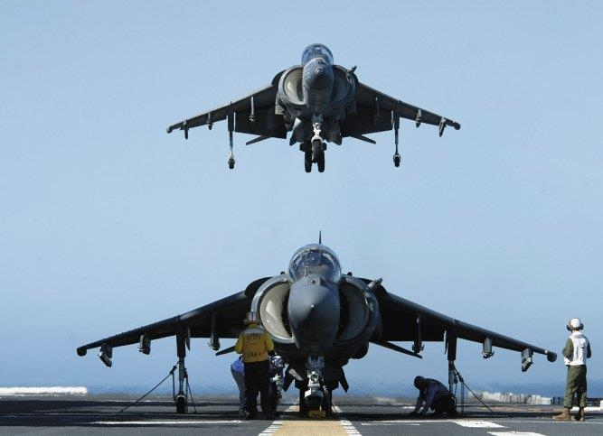 A U.S. Marine Corps AV-8B Harrier II prepares to land on the flight deck of the U.S. Navy's new amphibious assault ship, USS America, during maritime training operations off the coast of California on 25 February 2015. The ship is the first of its class and is optimised for Marine Corps aviation (U.S. Navy)