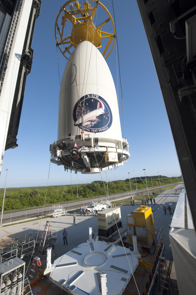 The Air Force's AFSPC-5 payload, encapsulated inside a 5-meter diameter payload fairing, is mated to an Atlas V booster inside the Vertical Integration Facility or VIF at Cape Canaveral Air Force Station's Space Launch Complex-41