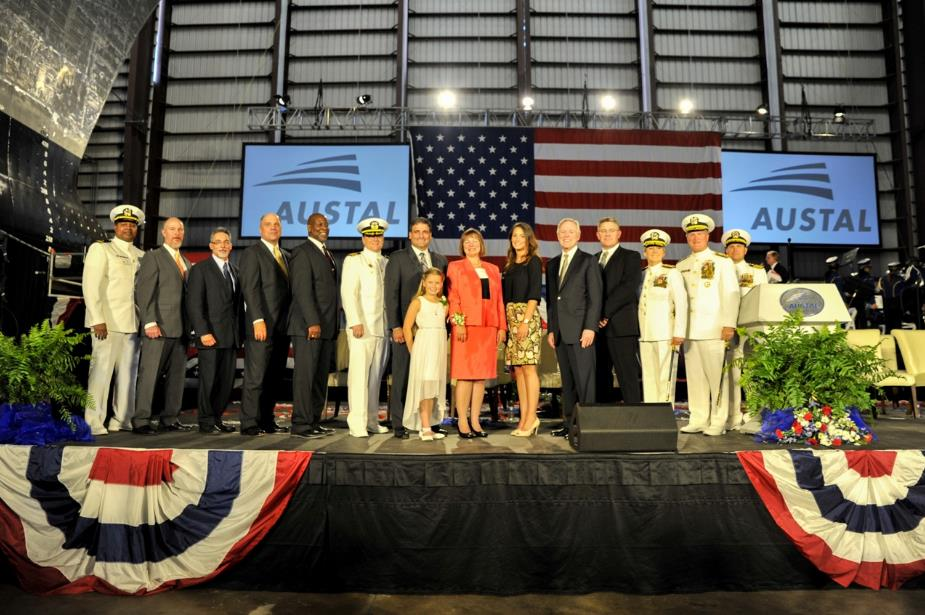 More than 300 naval guests, civic leaders, community members and Austal employees attended Saturday's ceremony, which was held beneath the hull of the Brunswick at Austal's shipyard