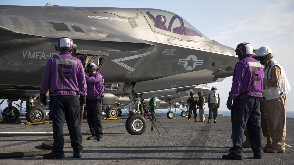 Marines and sailors aboard the USS Wasp (LHD-1) secure and refuel an F-35B Lightning II Joint Strike Fighter after its arrival for the first session of operational testing, May 18, 2015. Data and information gathered from OT-1 will lay the groundwork for F-35B deployments aboard Navy amphibious ships and the announcement of the Marine Corps' initial operating capacity of the F-35B in July (U.S. Marine Corps photo by Lance Cpl. Remington Hall/Released)