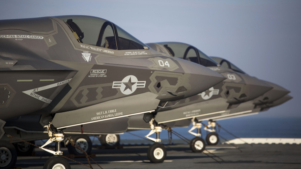 Four F-35B Lighting II Joing Strike Fighters (JSF) sit secured to the deck after their arrival aboard the USS Wasp (LHD-1), May 18, 2015. As the future of Marine Corps aviation, the F-35B will eventually replace all aircraft from three legacy Marine Corps platforms; the AV-8B Harrier, the F/A-18 Hornet, and the EA-6B Prowler (U.S. Marine Corps photo by Lance Cpl. Remington Hall/Released)