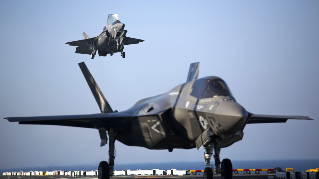 Two F-35B Lightning II Joint Strike Fighters complete vertical landings aboard the USS Wasp (LHD-1) during the opening day of the first session of operational testing, May 18, 2015 (U.S. Marine Corps photo by Lance Cpl. Remington Hall/Released)