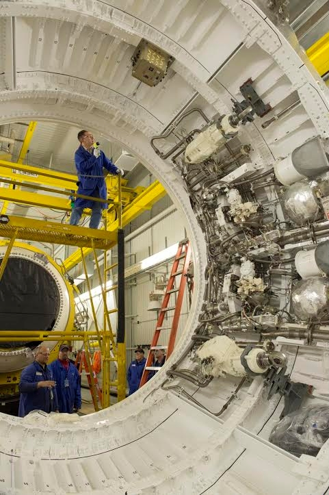 Orbital ATK technicians inspect the SLS Qualification Motor-1 booster after a successful test fire on March 11, 2015 (Photo Credit: Orbital ATK)