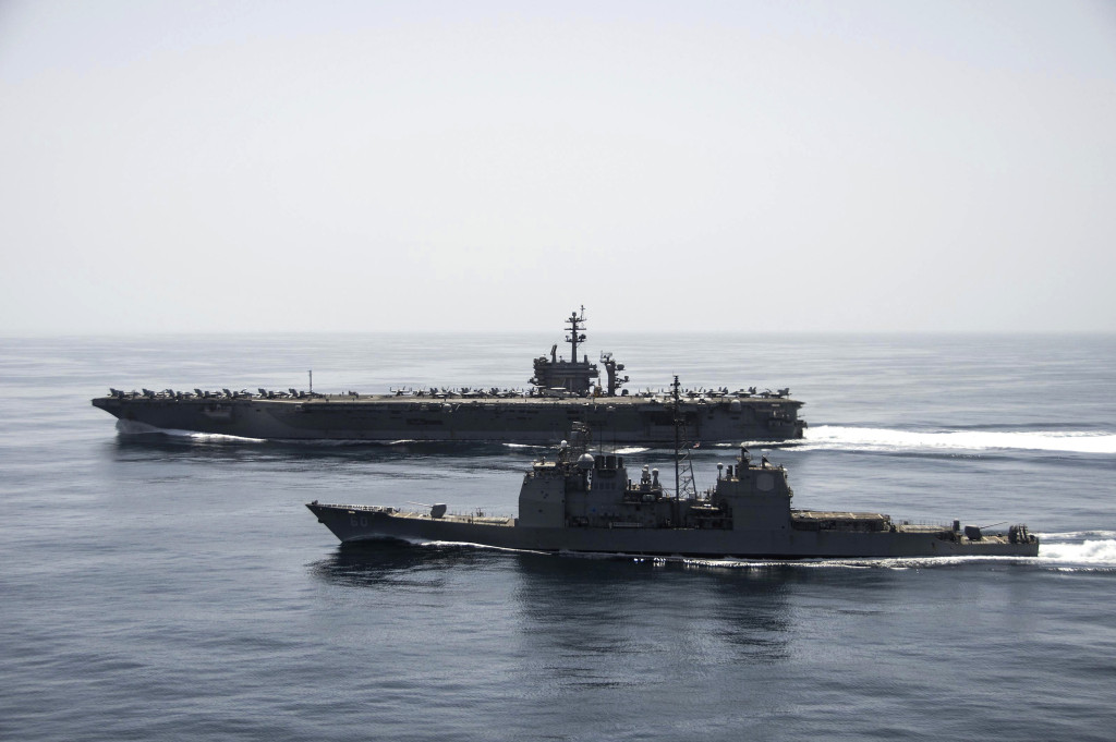 The aircraft carrier USS Theodore Roosevelt (CVN-71) and the guided-missile cruiser USS Normandy (CG-60) operate in the Arabian Sea conducting maritime security operations. (U.S. Navy photo by Mass Communication Specialist 3rd Class Anthony N. Hilkowski/Released)