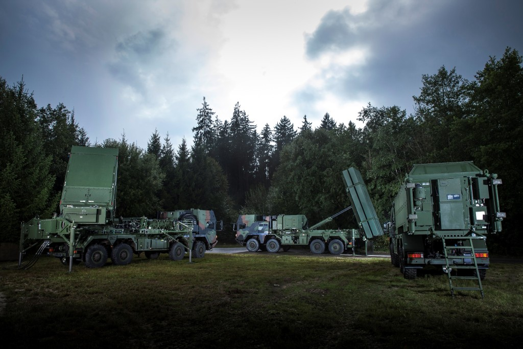 Shown in their German configurations, a MEADS Multifunction Fire Control Radar, launcher, and battle manager appear together near Freinhausen, Germany