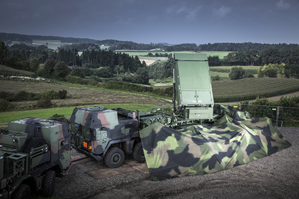 A MEADS MFCR is shown in deployed configuration in Germany. In European tests, the radar demonstrated tracking and canceling of jamming signals; searching, cueing, and tracking in ground clutter; and successfully classified target data using kinematic information