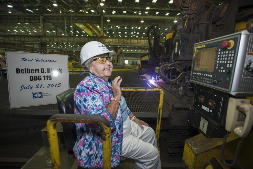 Ima Black reacts after starting a plasma cutter machine at Ingalls Shipbuilding, officially beginning construction of the Arleigh Burke-class destroyer Delbert D. Black (DDG-119), which is named in honor of her late husband (Photo by Andrew Young/HII)