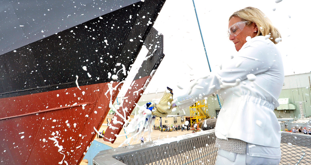 Ship sponsor Mrs. Janée Bonner conducted the time-honored tradition of christening the ship by smashing a bottle of champagne across the bow