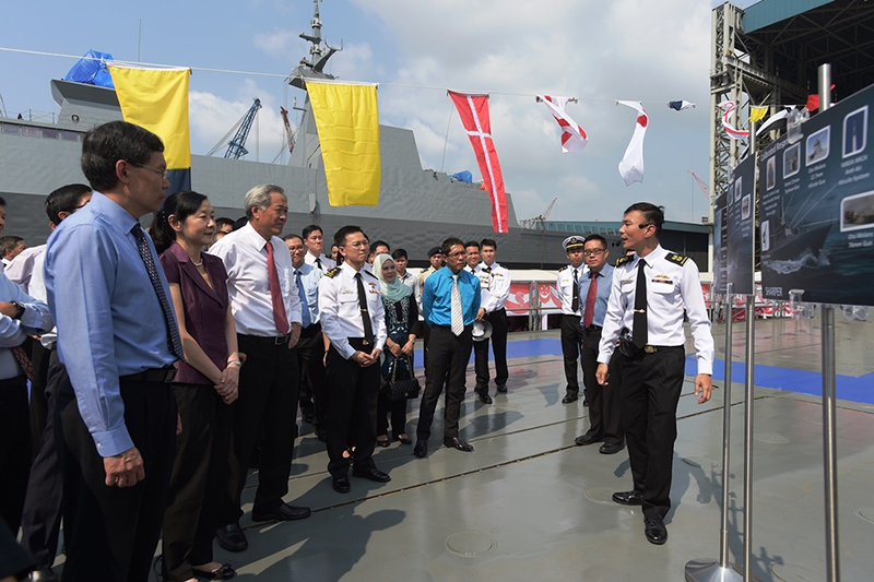 (From left) Second Minister for Defence Mr. Lui Tuck Yew, Mrs. Ng, Dr. Ng, Chief of Navy Rear-Admiral Lai Chung Han, Mrs. Maliki, and Minister of State for Defence Dr. Mohamad Maliki Bin Osman being briefed about the LMV on its deck