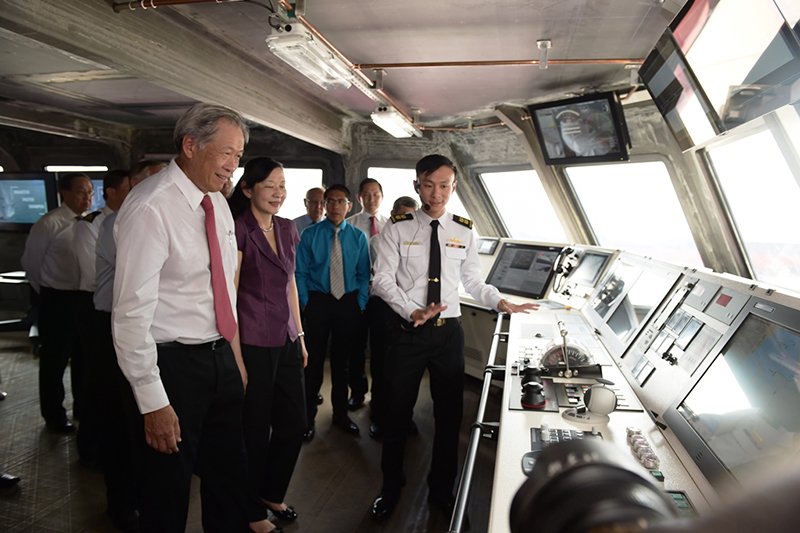 Dr. Ng (left) and Mrs. Ng being briefed by Lieutenant Colonel Chew Chun-Chau, Head of RSN's LMV Project Office, during a tour of the ship's Integrated Command Centre
