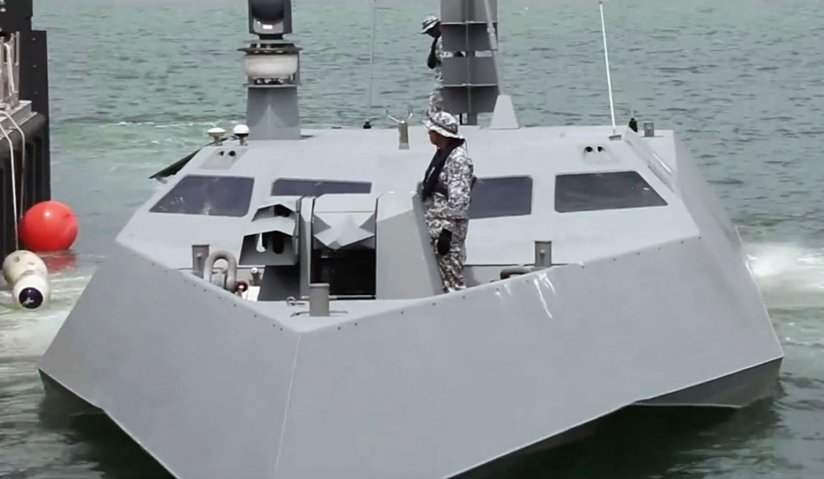 The vessel's electro-optical sensor and what is likely to be a navigation radar can be seen mounted on its starboard mast