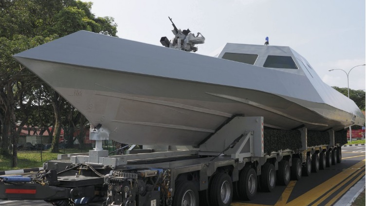 The vessel on parade is visibly less equipped than the model shown in a video, suggesting that this particular example is either a prototype or a newly built hull awaiting further outfitting
