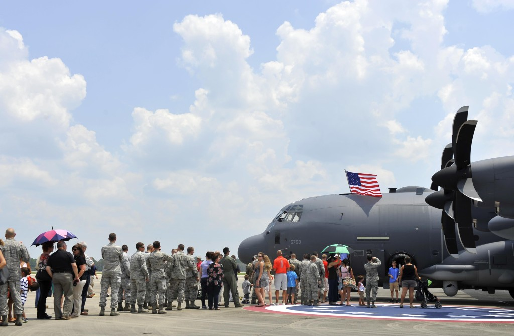 A crowd gathers to view the inside of the Air Force Special Operations Command's first AC-130J Ghostrider at Hurlburt Field, Florida, July 29, 2015. The aircrews of the 1st Special Operations Group Detachment 2 were hand selected from the AC-130 community for their operational expertise and will begin initial operational testing and evaluation of the AC-130J later this year (U.S. Air Force photo by Airman Kai White/Released)
