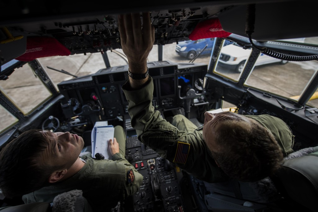 Master Sergeant James Knight right, an 18th Flight Test Squadron aerial gunner, instructs Staff Sergeant Rob Turner, left, a 1st Special Operations Group Detachment 2 aerial gunner, on new changes regarding preflight inspections in an AC-130J Ghostrider on Eglin Air Force Base, Florida, July 29, 2015 (U.S. Air Force photo/Senior Airman Christopher Callaway)
