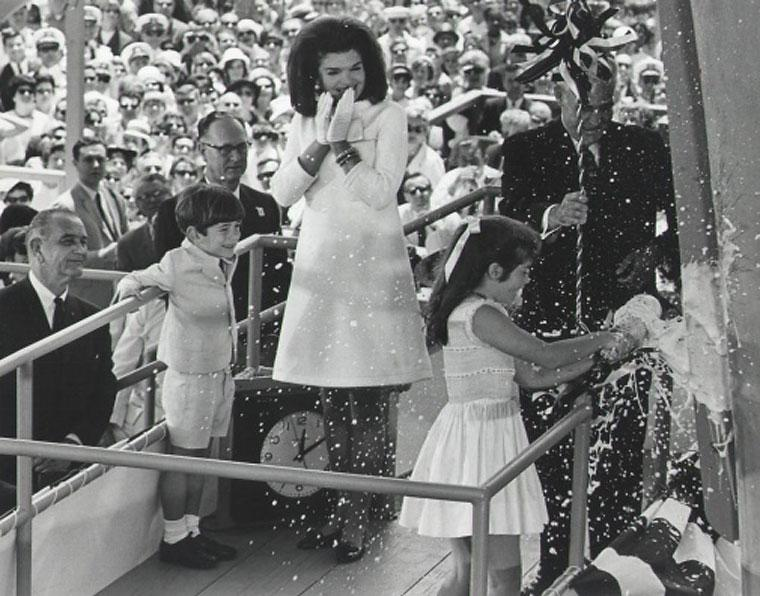 Caroline Kennedy smashes a bottle of American sparking wine across the bow of USS John F. Kennedy (CVA-67) in 1967 (Image courtesy of the Daily Press)