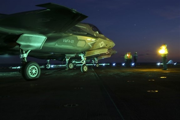 An F-35B Lightning II prepares to taxi on the flight deck of the USS Wasp during night operations at sea as part of a Marine Corps operational test, May, 22, 2015 (U.S. Marine Corps photo by Corporal Anne K. Henry)