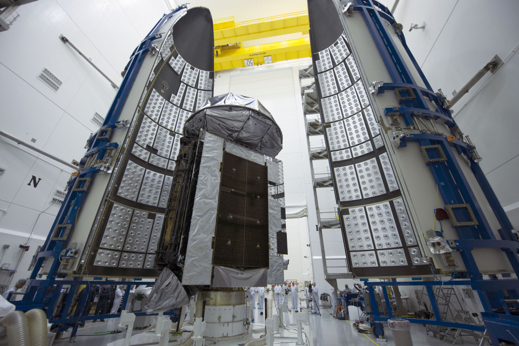 MUOS-4, the next satellite scheduled to join the U.S. Navy's Mobile User Objective System secure communications network, has been encapsulated in its protective launch vehicle fairing for its August 31 launch from Cape Canaveral Air Force Station (photos courtesy of United Launch Alliance)
