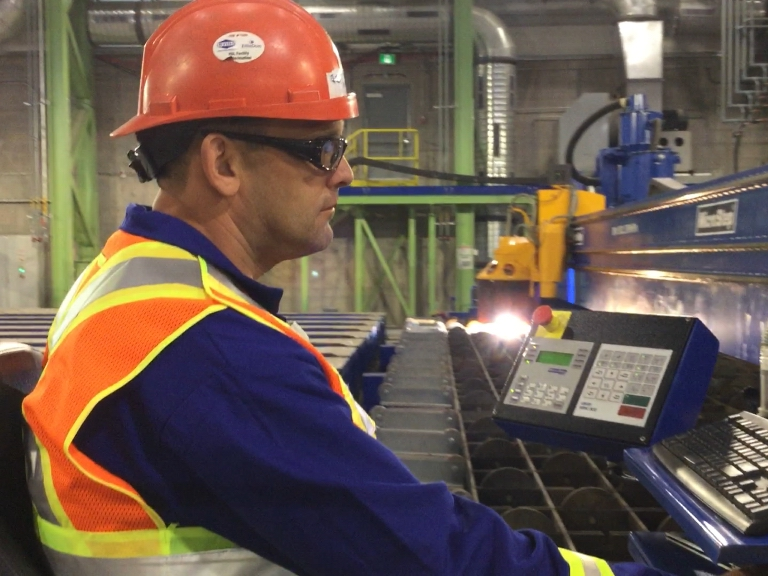 Halifax Shipyard worker cuts components for the first AOPS ship using state-of-the-art plasma cutter