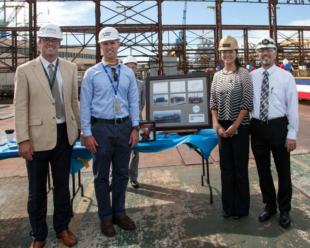 Bud McKay, program manager; Dan Reed, manager of steel; Paola Gerardo, honoree; and Ian Busch, manager for initial design for naval architecture