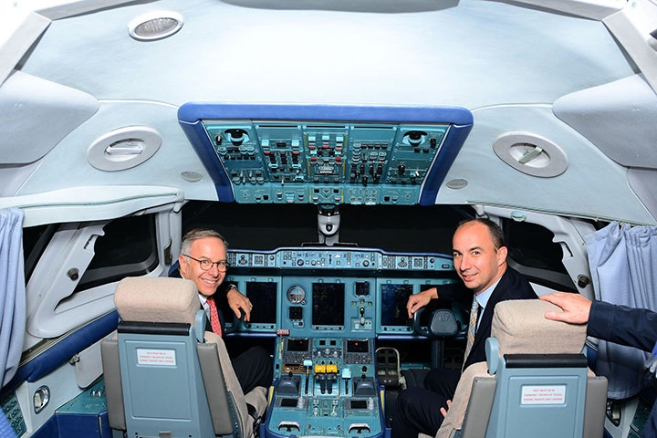Richard Dussault (left) and Frederic Lefebvre in flight simulator of the AN-148