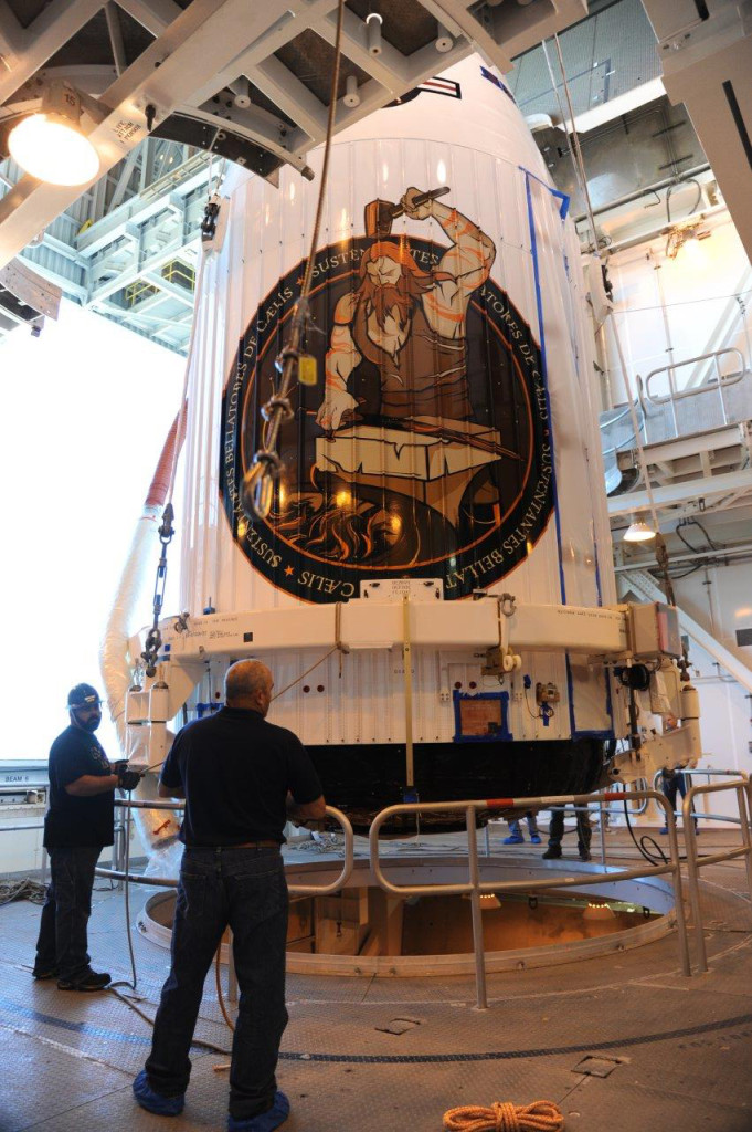 The NROL-55 payload, encapsulated in a 4-meter diameter payload fairing, is mated to an Atlas V booster inside the Mobile Service Tower or MST at Vandenberg's Space Launch Complex-3