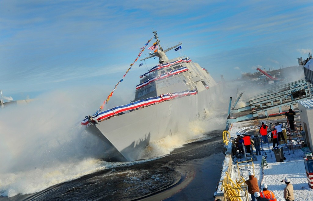 The littoral combat ship USS Milwaukee (LCS-5) slides into the Menominee River during a christening ceremony at the Marinette Marine Corporation shipyard (U.S. Navy photo courtesy of Lockheed Martin/Released)