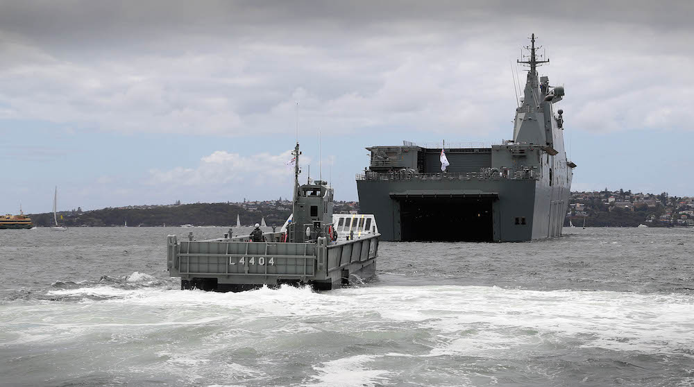 HMAS Canberra docks down in Sydney Harbour in order to receive the ship's LHD Landing Craft for the very first time