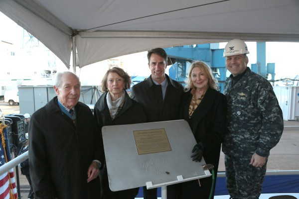 Thomas Hudner Jr., Georgea Hudner, Thomas Hudner III, Mrs. Barbara Miller and Captain Mark Vandroff with the keel plate of the future USS Thomas Hudner