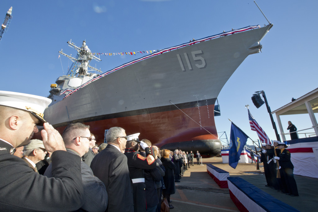 151031-M-SA716-052 BATH, Maine (Oct. 31, 2015) U.S. Marines, Sailors, and guests honor the American and Navy flag during the USS Rafael Peralta christening ceremony at General Dynamics Bath Iron Works, Bath, Maine, Oct. 31, 2015. The destroyer was named after Marine Corps Sgt. Rafael Peralta who was killed during the second battle of Fallujah in 2004. (U.S. Marine Corps photo Sgt. Gabriela Garcia/Released)