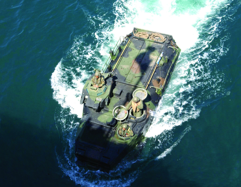 At sea, a 400 hp turbocharged diesel V-8 engine with propulsion enabled by two 14,000 gpm water jet pumps provides AAV7A1 vehicles with a cruising speed of 7 knots and the ability to negotiate 10-foot plunging surfs heading either seaward or to shore