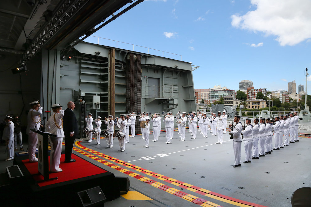 The Governor General of Australia, His Excellency General, the Honourable Sir Peter Cosgrove, AK, MC, (Retd), receives a Royal Salute from the band and Commissioning Guard during HMAS Adelaide's Commissioning ceremony