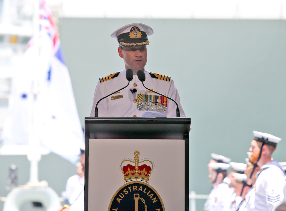 Commanding Officer of HMAS Adelaide (L01), Captain Paul Mandziy, CSC, RAN, addresses guests during the ship's Commissioning Ceremony