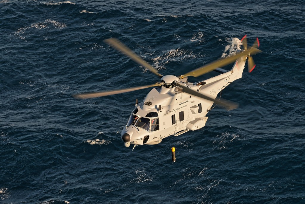 Specialized naval helicopter with underwater sonar system, tactical radar and high cabin